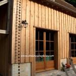 descente de gouttière esthétique associée à un bardage en bois