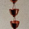 Zenloki est une gouttière décorative en cuivre originale.